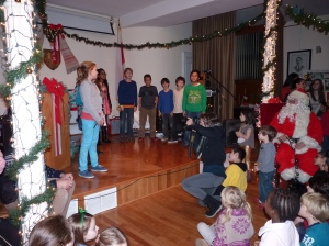 Children from Public School 261 sing holiday songs