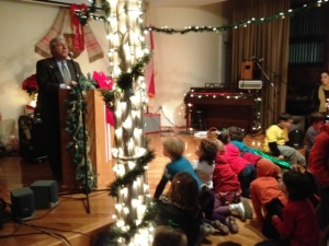 During the Atlantic Avenue Tree Lighting event, children listen with great interest as Brooklyn's Borough President Marty Markowitz talks about Hurricane Sandy and gives respect to the diversity of Brooklyn and its various religions.